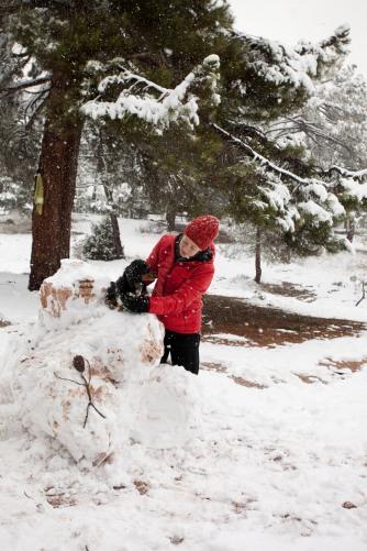 Snow boulder and bouderer.